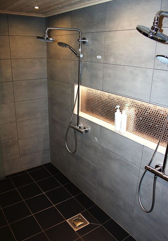 some built-in shower lights on the ceiling and a lit up niche for a cozy feel in the shower