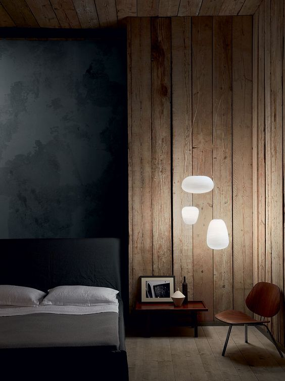 these modern floating pendant lamps remind of clouds and brighten up the moody bedroom