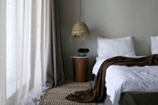 24 a bedroom with much texture – jute, wicker, various textiles and concrete walls and floors