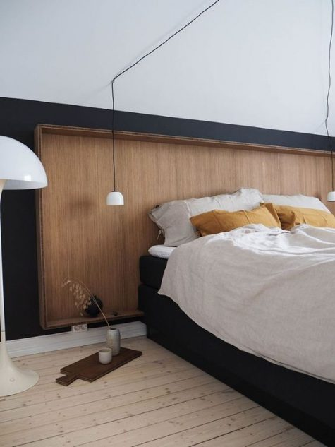 a sleek wooden headboard with a frame matches this Scandinavian bedroom and looks pretty and chic