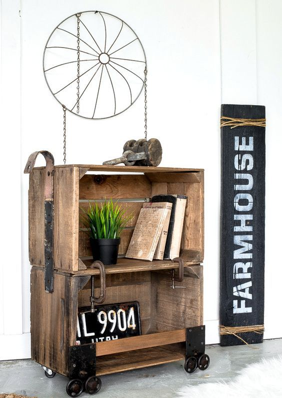 a stained coffee crate side table on casters with industrial detailing is a bold idea