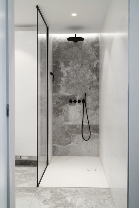 built in LEDs and a light in the ceiling are enough to light up such a small shower space