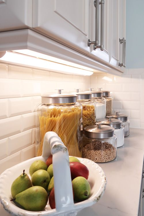 install some lamps or LED lights under the cabinets to make all the countertops lit up