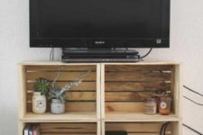 25 a TV unit made of crates is a simple and stylish idea with plenty of storage that can be made very fast and easily