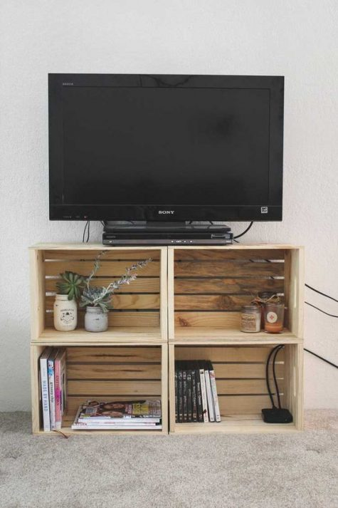 a TV unit made of crates is a simple and stylish idea with plenty of storage that can be made very fast and easily