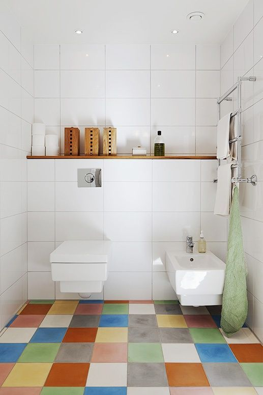 a bathroom spruced up with colorful tiles on the floor to make it catchier and cooler