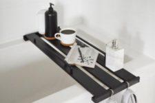 25 an Ikea Hejne bookcase shelf transformed into a stylish bathtub tray and stained dark
