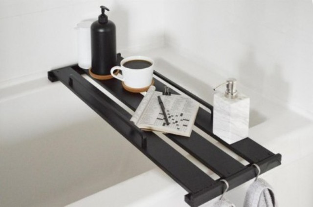 an Ikea Hejne bookcase shelf transformed into a stylish bathtub tray and stained dark