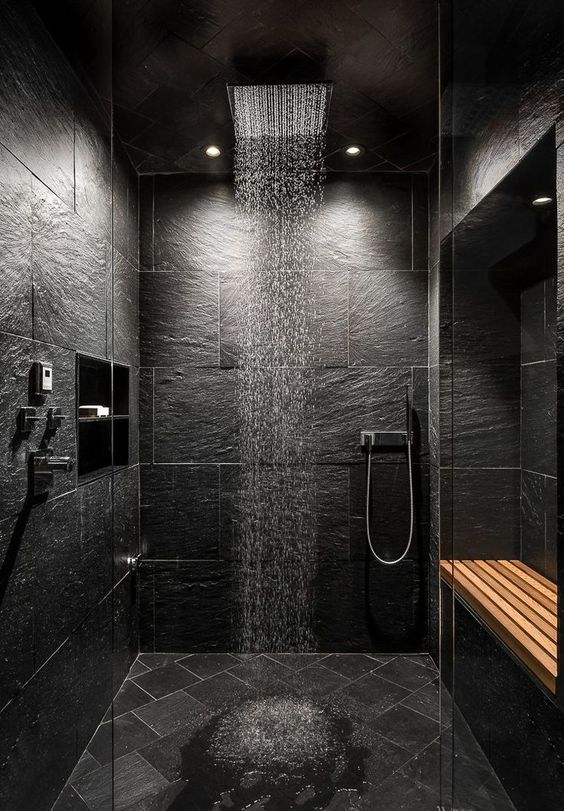 a moody shower design in dark tones and good lights