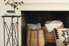 25 style your non-working fireplace with baskets with blankets and throws and a faux fur rug