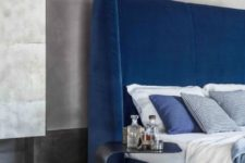 26 an ultra modern electric blue wingback headboard accented with a catchy curved nightstand