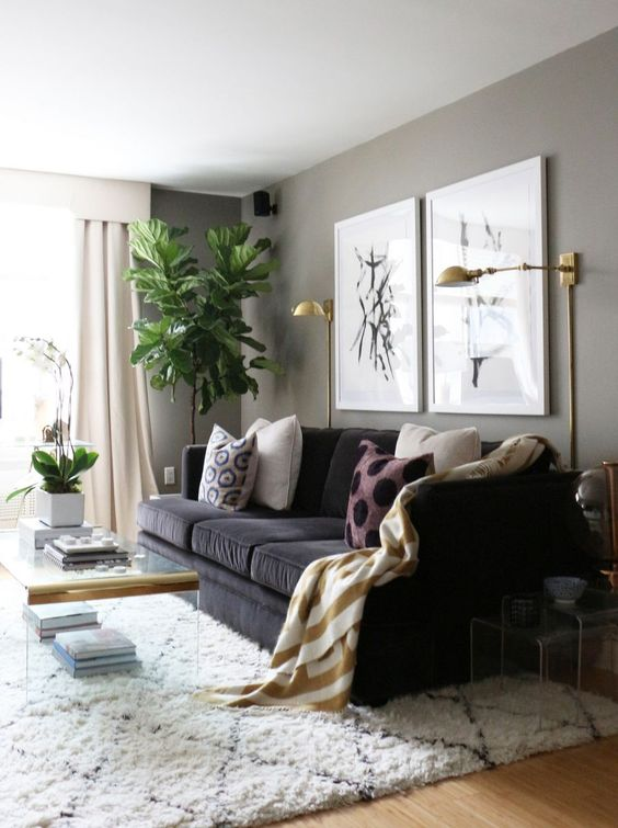 some brass wall sconces add a glam feel to the living room and provide some light, too