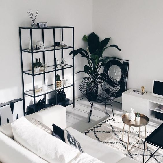 a Nordic living room done in white mostly and with some touches of black to make it more contrasting and dramatic