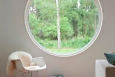 a large round window that brigns in much light and lets the owners enjoy the views a lot
