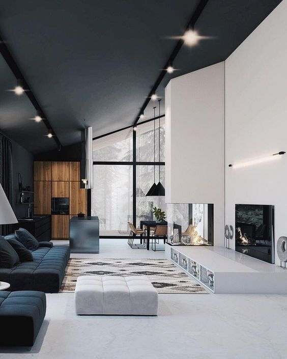 a minimalist living room with a built in firpelace, a sleek platform, black and white furniture and simple lights