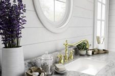 a kitchen design in farmhouse style with pothole windows