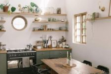 a small porthole window sprucing up a boho and mid-century modern kitchen and making it catchier