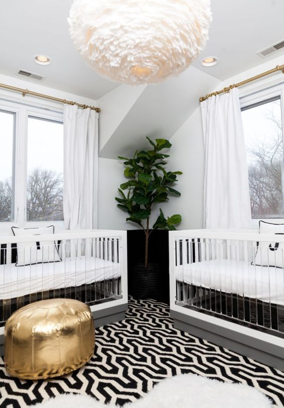 a stylish modern shared nursery with a printed rug, a gold ottoman, a faux fur rug, comfy cribs and a fluffy lamp