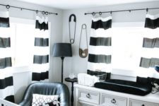 a stylish nursery with a vintage dresser, striped curtains, printed bedding and a faux fur rug