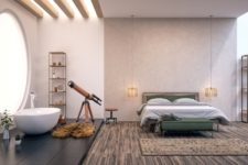 an open space with a bedroom and a bathroom with a giant porthole window with opaque glass to keep it private