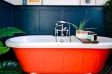 02 a bright orange bathtub with claw feet is a cool fall-inspired idea for a bathroom and will raise the spirits