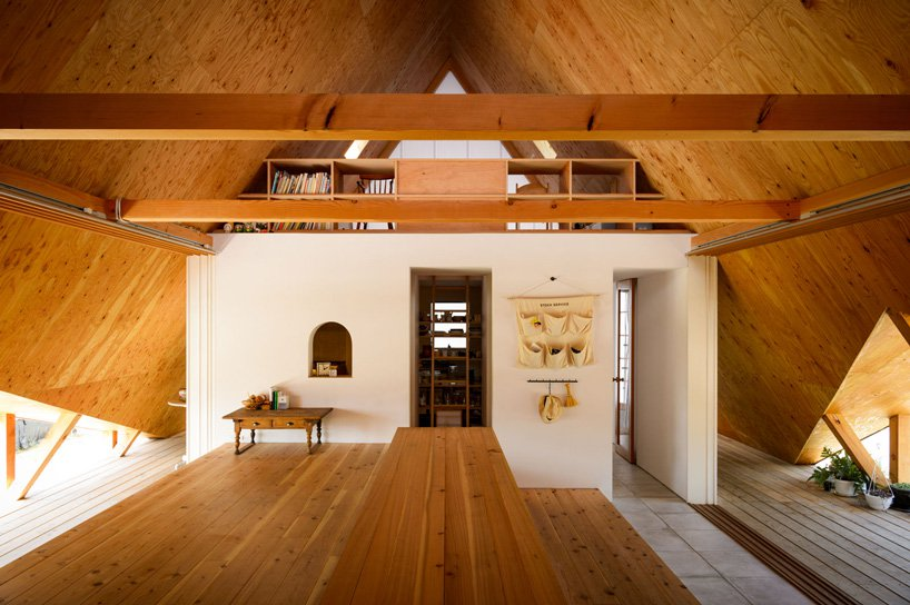 The interiors are minimalist, done with light stained wood and plywood and some sleek white surfaces