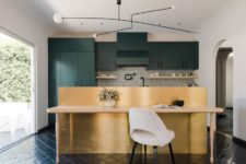 03 There's also a metal wall that hides the bar and separates the space from the desk