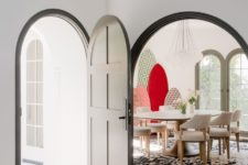 04 The dining space is accentuated with a printed rug, bold surf boards and a cluster of pendant lamps