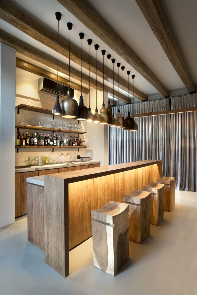 a stylish home bar design with interesting hidden lighting