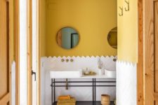 04 mustard paint brings a fall feel to the bathroom and makes it cool and fall-like
