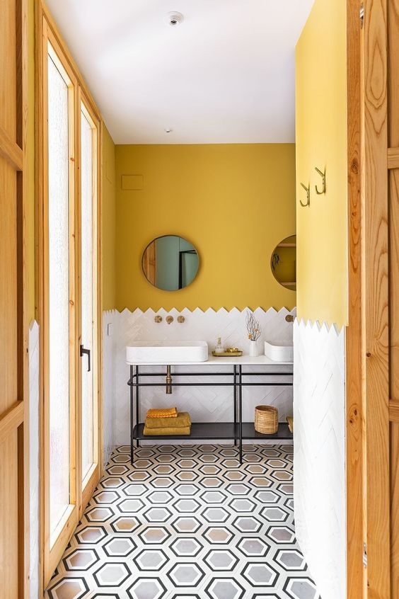 mustard paint brings a fall feel to the bathroom and makes it cool and fall-like