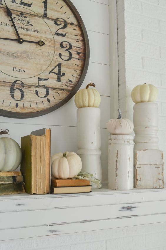 take rustic candleholders and use them pumpkins stands for the fall, it's a very creative idea