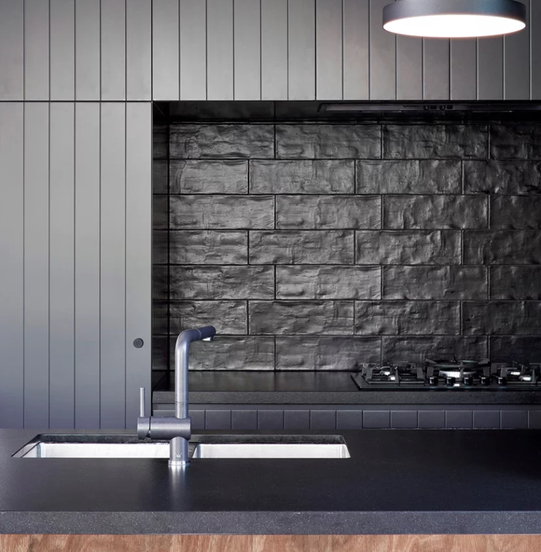 The kitchen will remind you of Japanese minimalism and the textural tiles on the backsplash give interest to it
