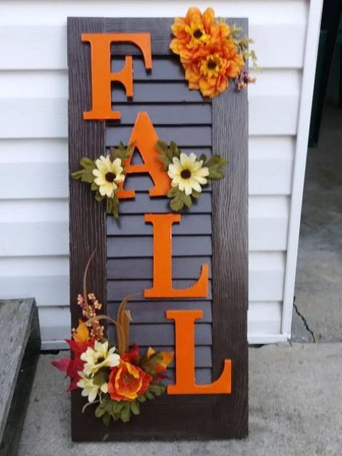 an old shutter repurposed into a cool and bright fall sign, a creative and budget-friendly idea