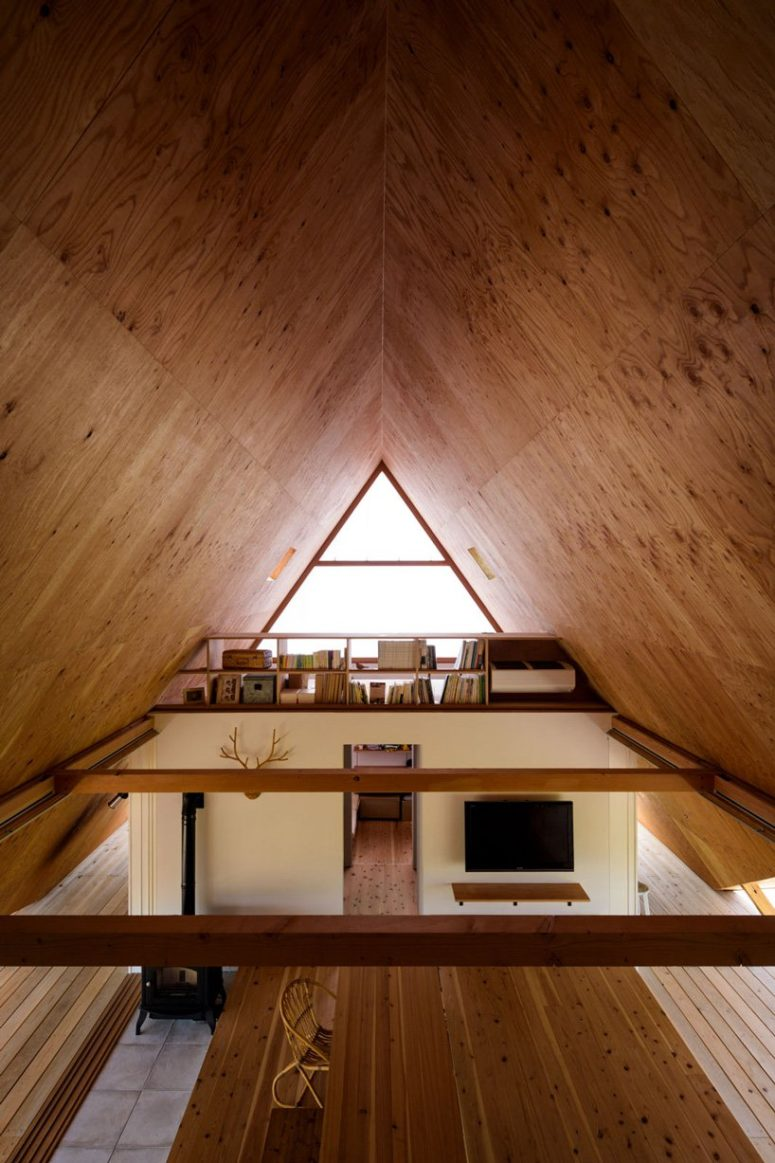 Large triangle glazed windows make the spaces filled with light
