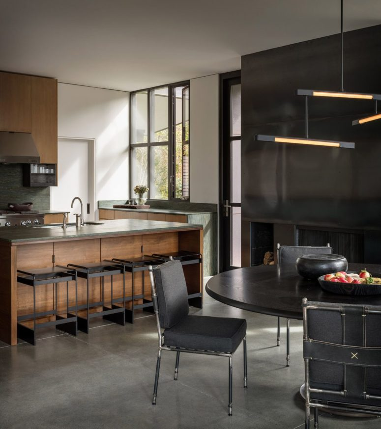 Natural rich-stained wood, stone and dark metals are used in such an elegant way that it takes your breath away