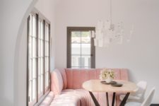 06 The breakfast zone shows off a pink upholstered corner sofa and some white chairs