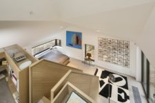 06 The layout features two levels with living, sleeping, working and office zones and each of them is accented visually
