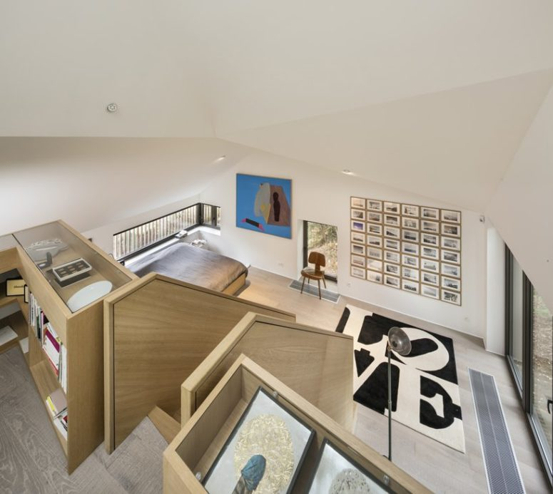 The layout features two levels with living, sleeping, working and office zones and each of them is accented visually