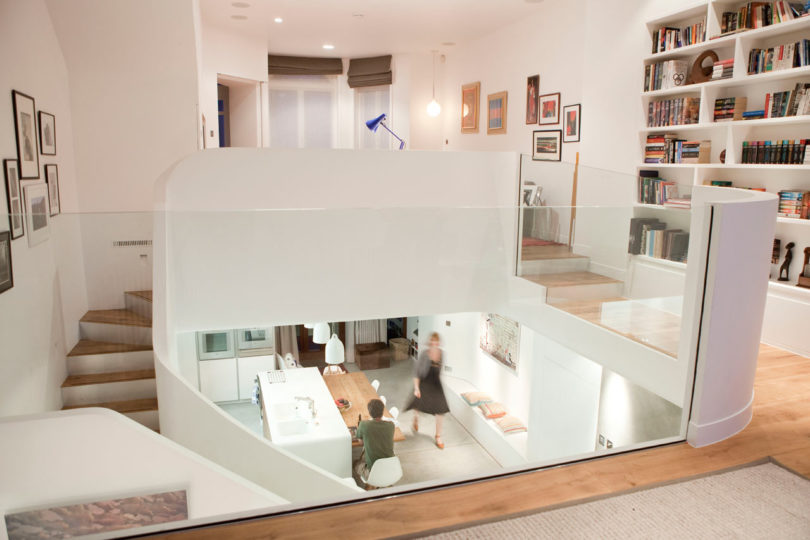 The staircase was an element of decor with its sleek white surfaces and glass railings