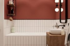 06 a burgundy wall paired with neutral tiles with matching grout is a cool fall-like idea