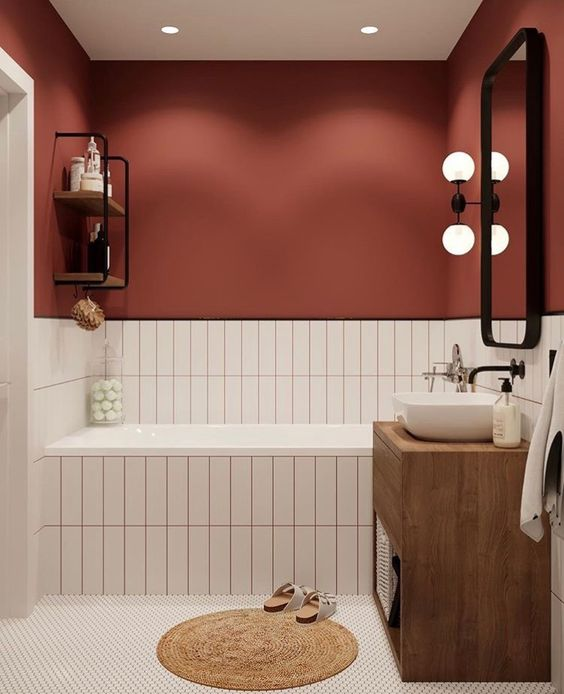 a burgundy wall paired with neutral tiles with matching grout is a cool fall-like idea