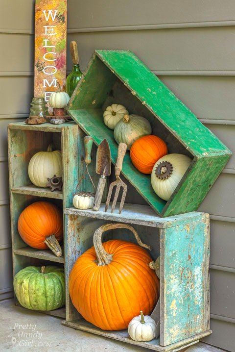 use old shabby chic crates to create a bold pumpkin display on your porch