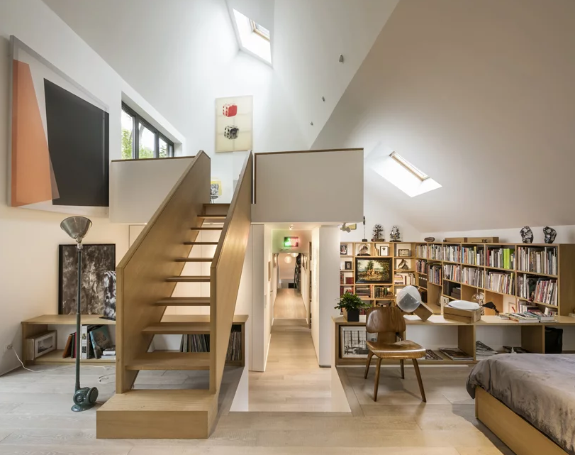 The extension is done in a neutral color palette, with uch light colored wood and plywood