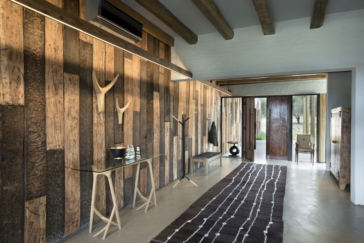 You'll see all shades of relcaimed and regular wood throughout the house and outdoors spaces, and glass and metal, too