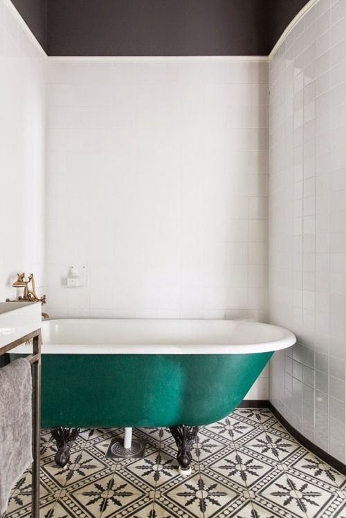 an emerald bathtub will not only make your monochromatic bathroom bold but also will hint on the fall