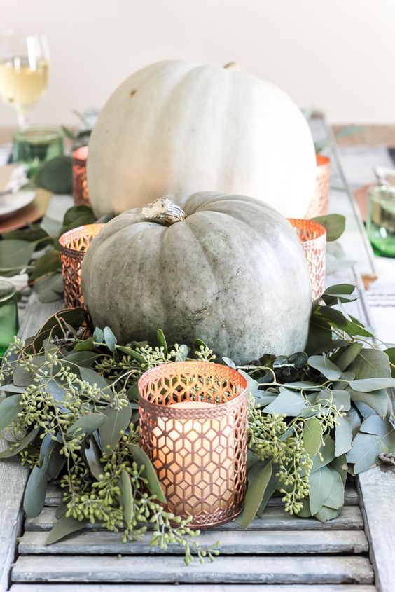 large heirloom pumpkins are amazing for decorating for the fall, add soem fresh eucalyptus and candles and a cool centerpiece is ready