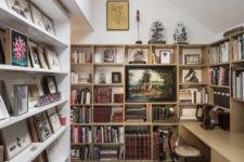 08 The study features endless bookshelves and a built-in desk plus some artworks