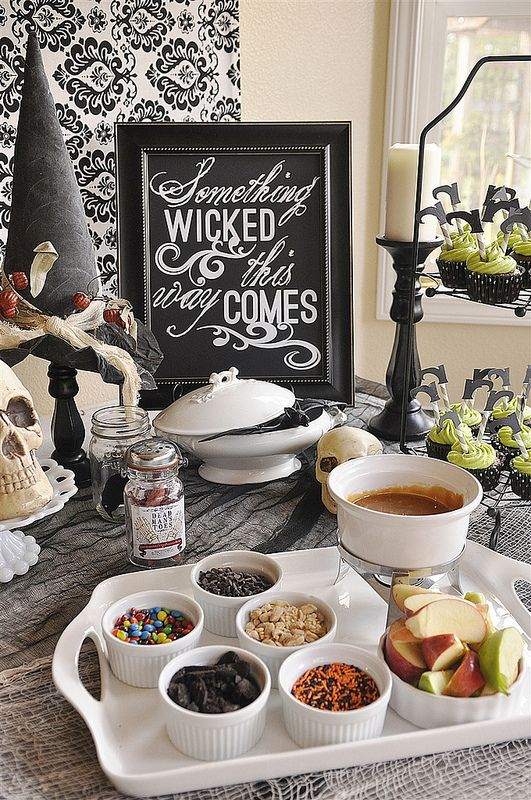 style the food bar with a sign, skulls, a witch hat and some witch shoes toppers on the cupcakes