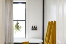 09 a set of mustard towels is a budget-friendly and easy way to bring a fall feel to your bathroom